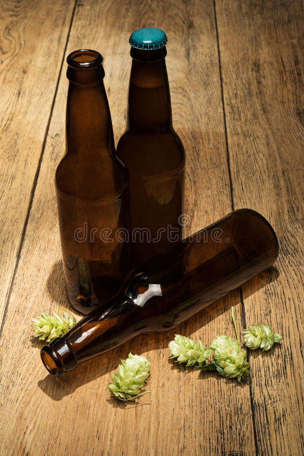 Free Three Bottles Of Beer And Hops Royalty Free Stock Photos - 79398888
