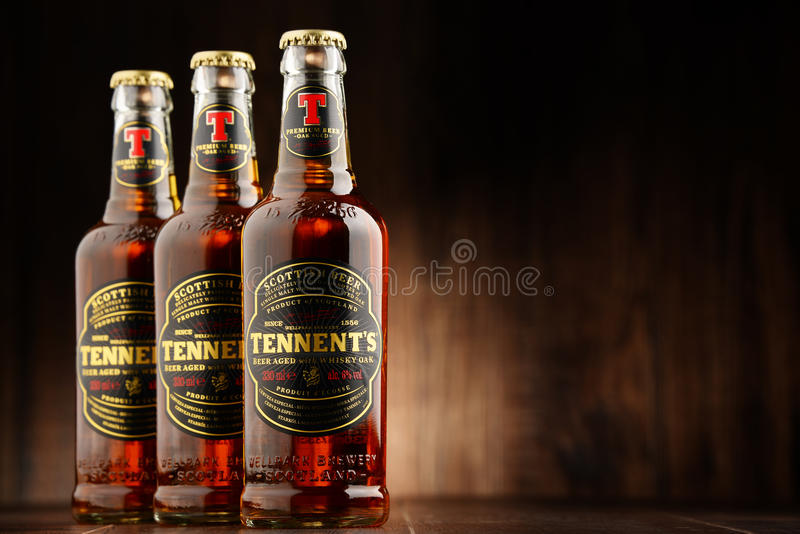 Three bottles ofTennents Whisky Oak beer. POZNAN, POLAND - AUGUST 12, 2016: Tennents Whisky Oak is a brand of beer produced by Wellpark Brewery in Glasgow stock photo