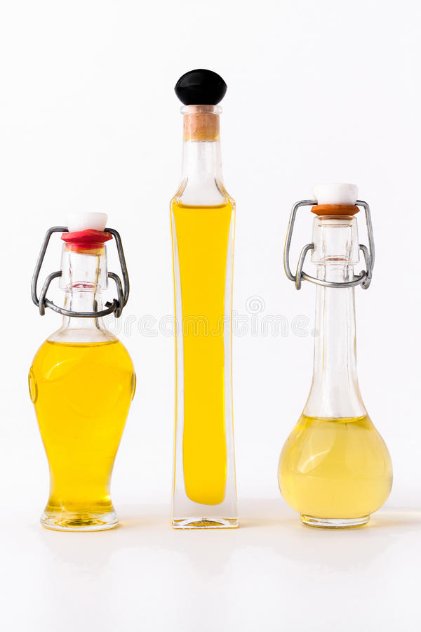 Three bottles of olive oil stock photos
