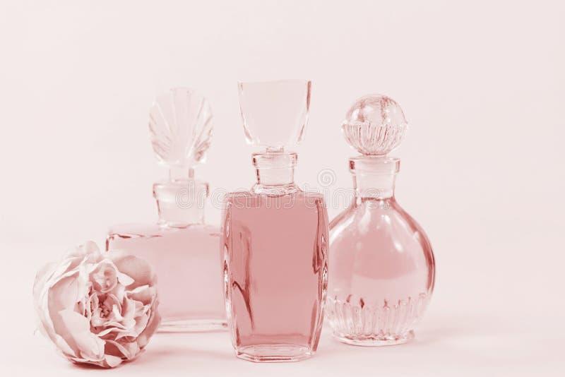 Three bottles vintage perfume stock image
