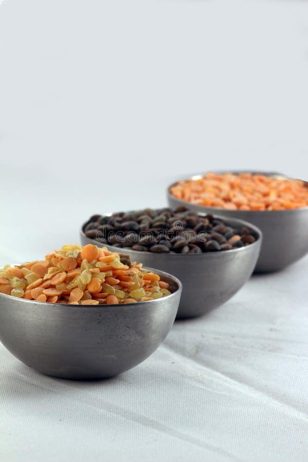 Three bowls of lentil royalty free stock photo