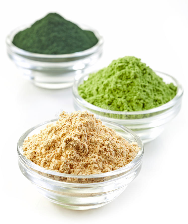 Three bowls of various superfood powders stock photos