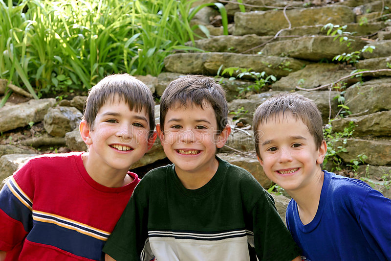 Download Three Boys stock image. Image of families, love, companionship - 2930961