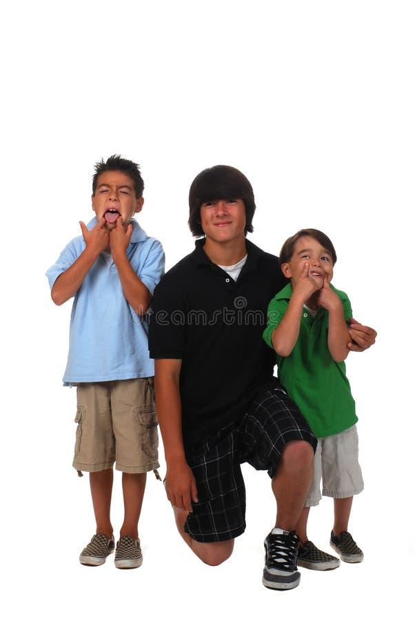 Download Three Boys stock image. Image of three, goof, sticking - 6250993