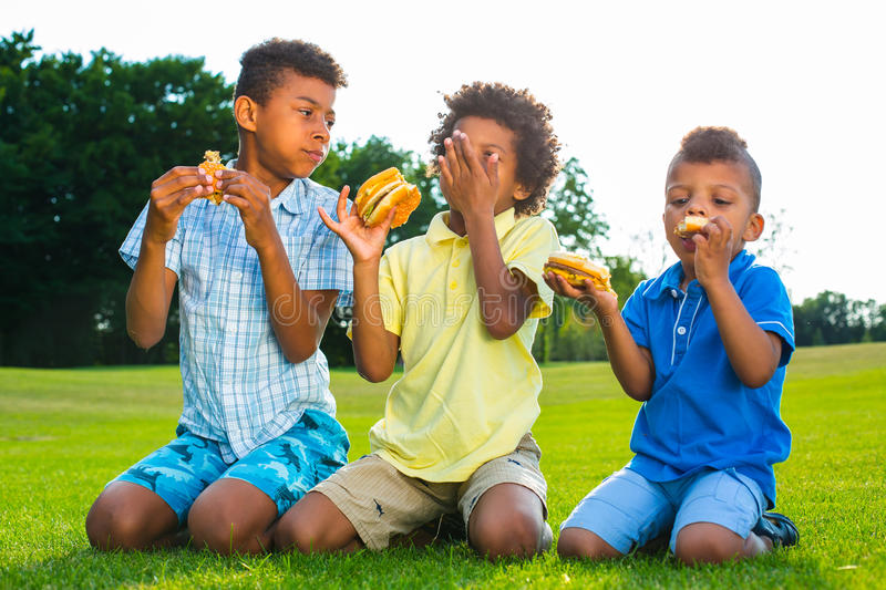 Three boys are eating. royalty free stock images