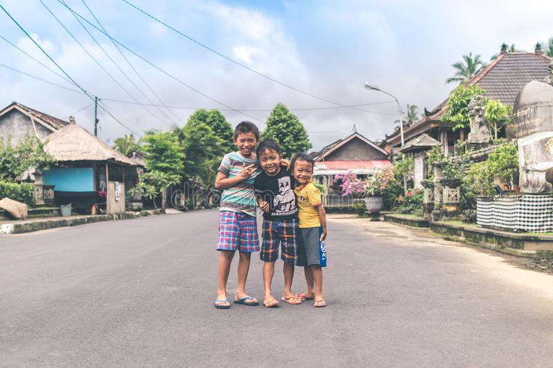 Three Boys Standing on Road stock photography