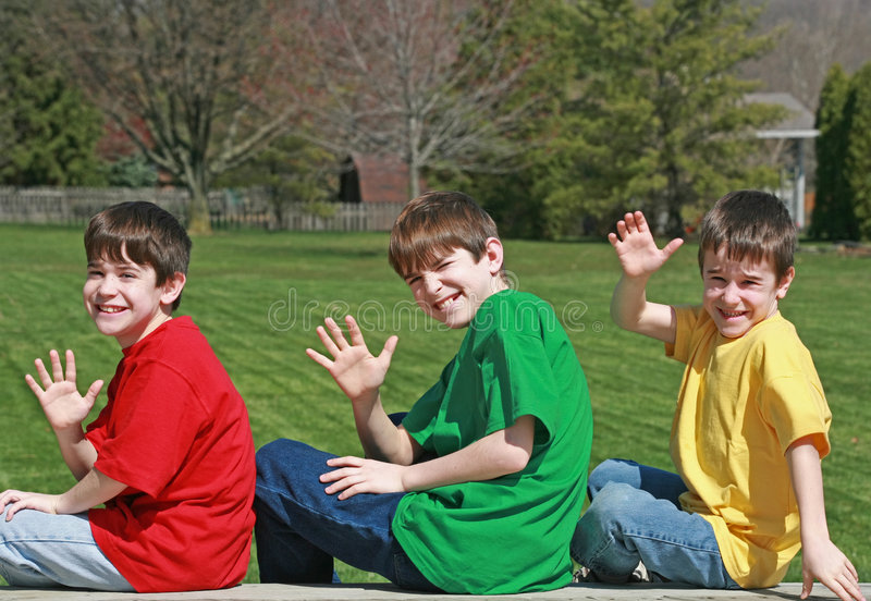 Three Boys Waving Royalty Free Stock Images