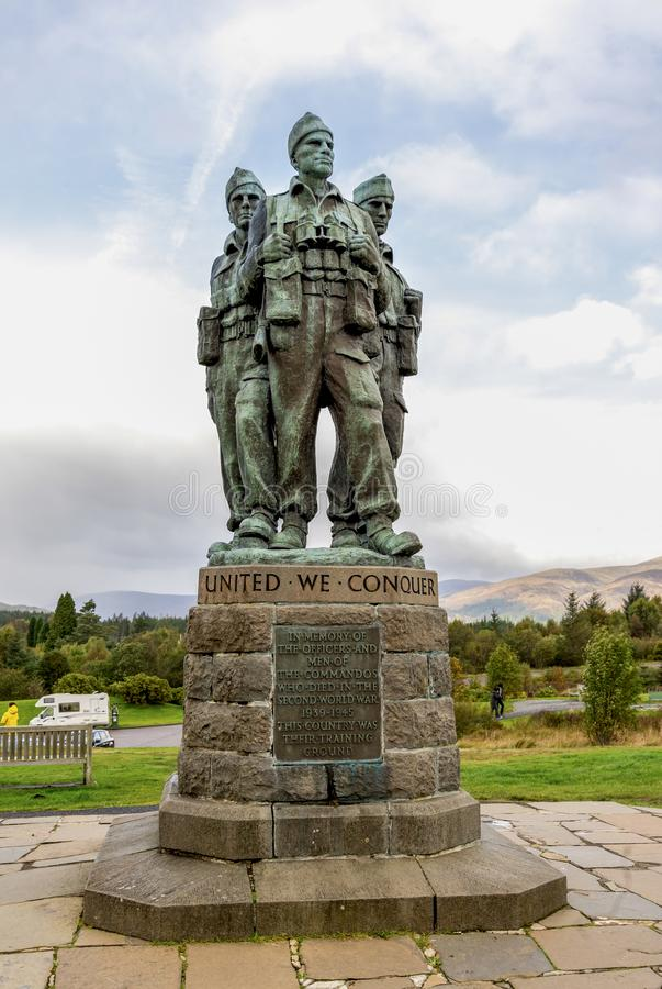 Three British commandos of the Commando Memorial looking towards Ben Nevis mountain near Spean Bridge village in Scottish Highland. S, October 2017 royalty free stock image