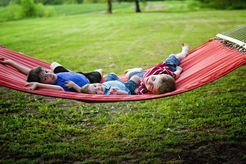 Little boys on hammock stock photos