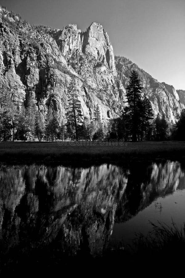 Three Brothers reflection in Merced, Yosemite Valley. Yosemite National Park, California stock image