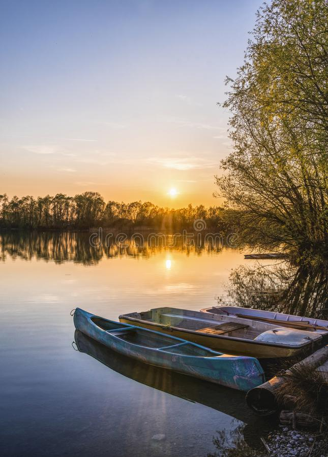 Three Brown Canoes Under Golden Hour stock photos