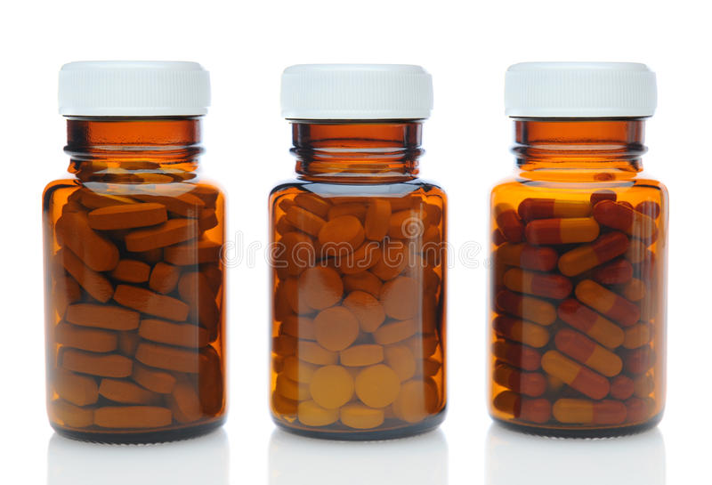 Download Three Brown Medicine Bottles With Different Drugs Stock Photo - Image: 34282588