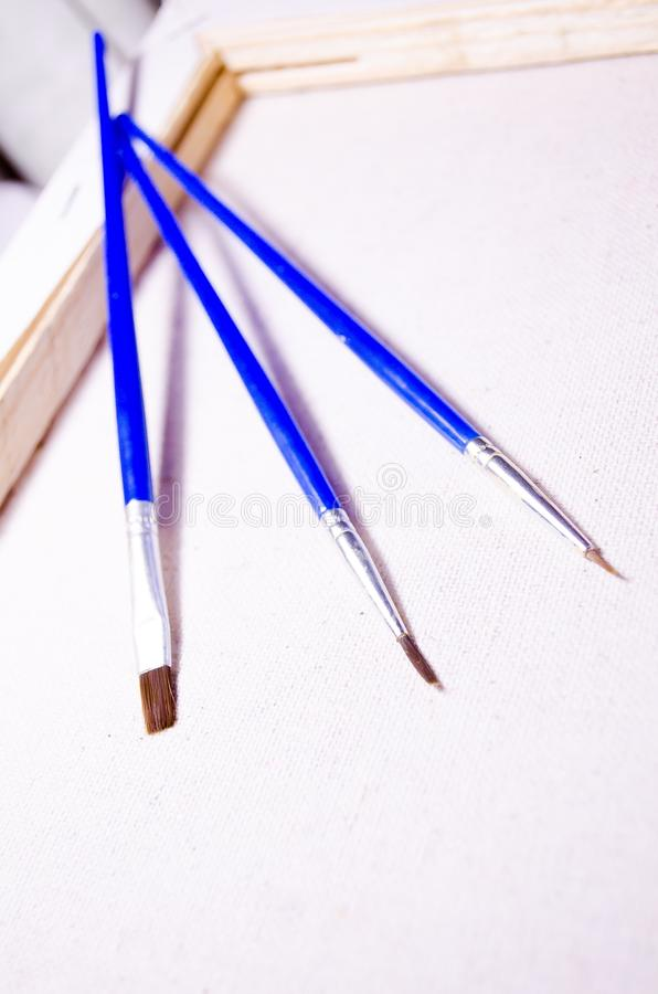 Three brushes. Drawing set. Stretcher. Canvas. Tree. stock images