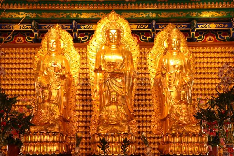 Three Buddha images. Three Buddha images in pavilion of Chinese temple, Nonthaburi, Thailand stock photos