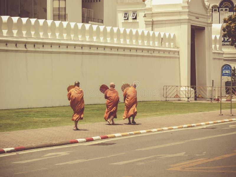 Three Buddhist monks in front of royal palace Bangkok royalty free stock photo