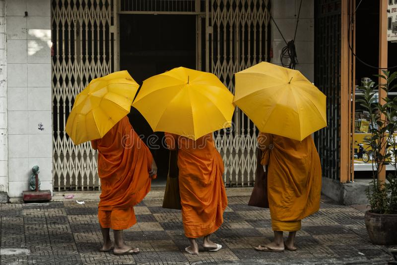 Three monks on the street royalty free stock photos