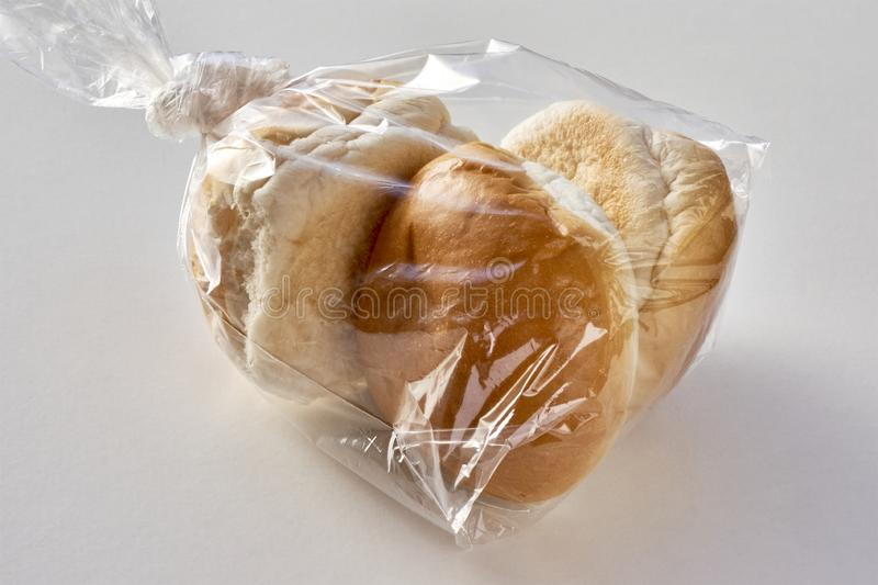 Three buns in a plastic bag royalty free stock image