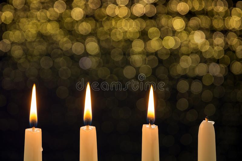 Three burning candles on the third advent royalty free stock photography