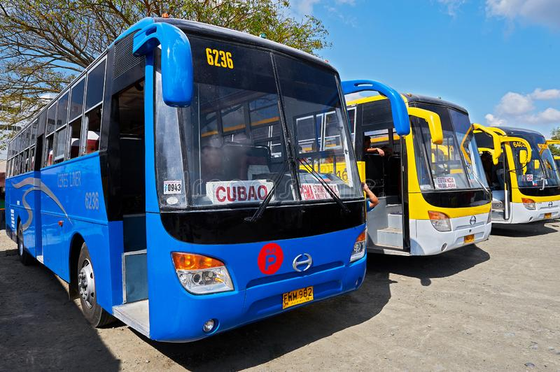 Three buses of the Ceres liner in the Philippines. Iloilo City, Iloilo Province, Philippines: Three buses of the Ceres liner company standing in line at the stock image