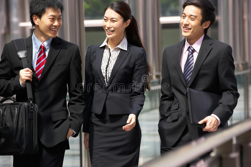 Download Three Business Colleagues Having Discussion Stock Photo - Image: 26095604