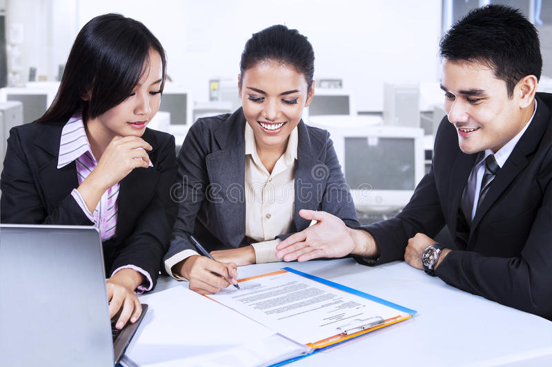 Download Three Business Partners In Meeting Stock Photo - Image: 35803358