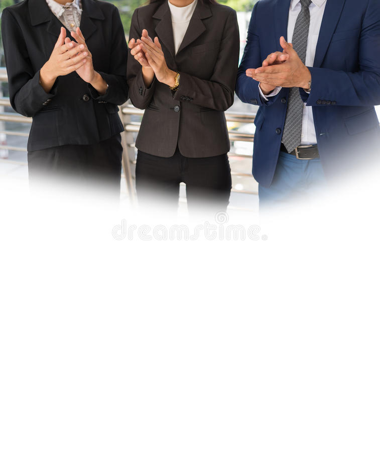 Three business people clap their hands to congratulate the signing of an agreement or contract between their companies stock photography