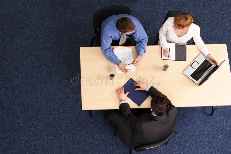 Three business people meeting royalty free stock images