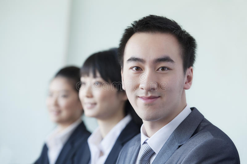 Download Three Business People In A Row Smiling Stock Image - Image: 33371239