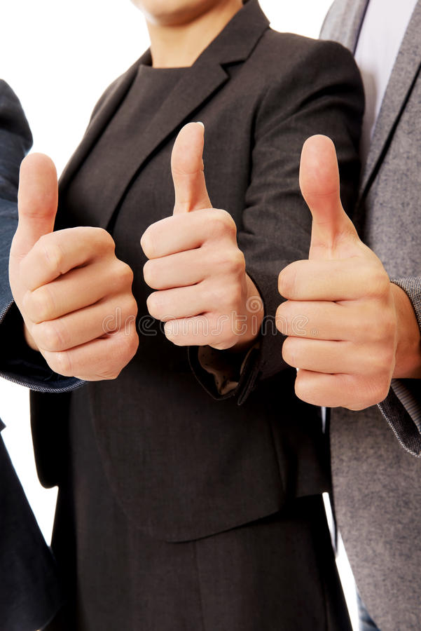 Three business people showing thumbs up stock photos