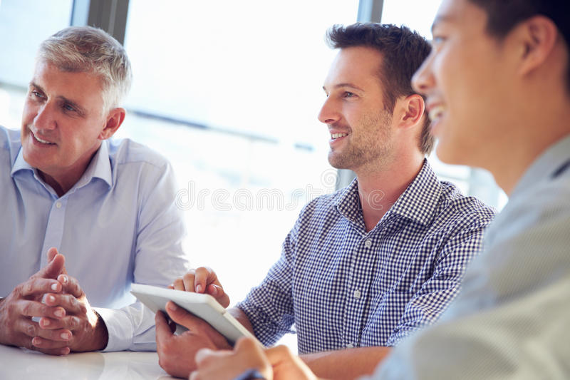 Three business professionals working together royalty free stock photography