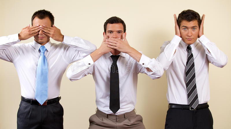 Three businessman covering eyes, mouth and ears royalty free stock image
