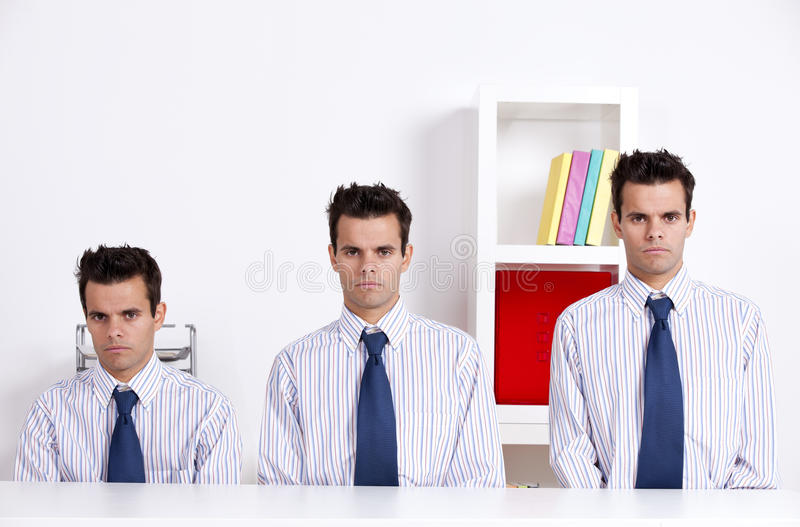 Three businessman with diferent sizes stock images