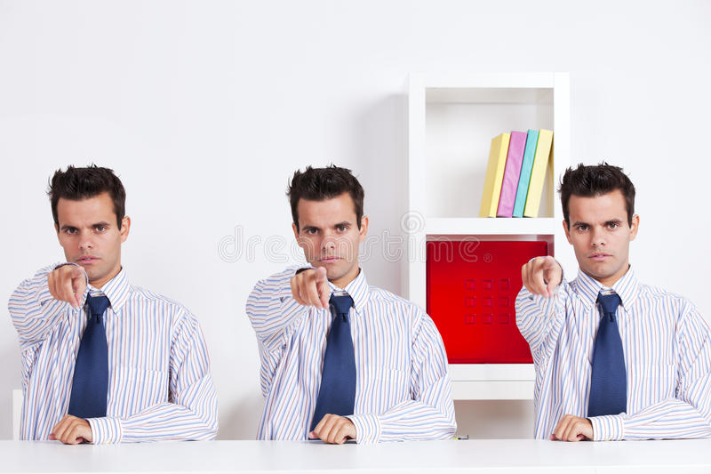 Three businessman pointing stock photo