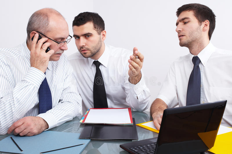 Download Three Businessman Sitting At Table During Meeting Stock Image - Image: 23190205