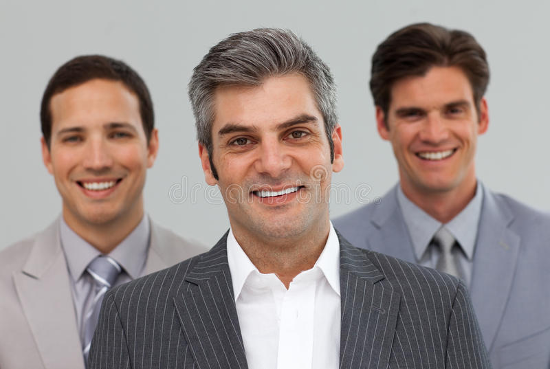 Download Three Businessmen Smiling At The Camera Royalty Free Stock Images - Image: 12191359