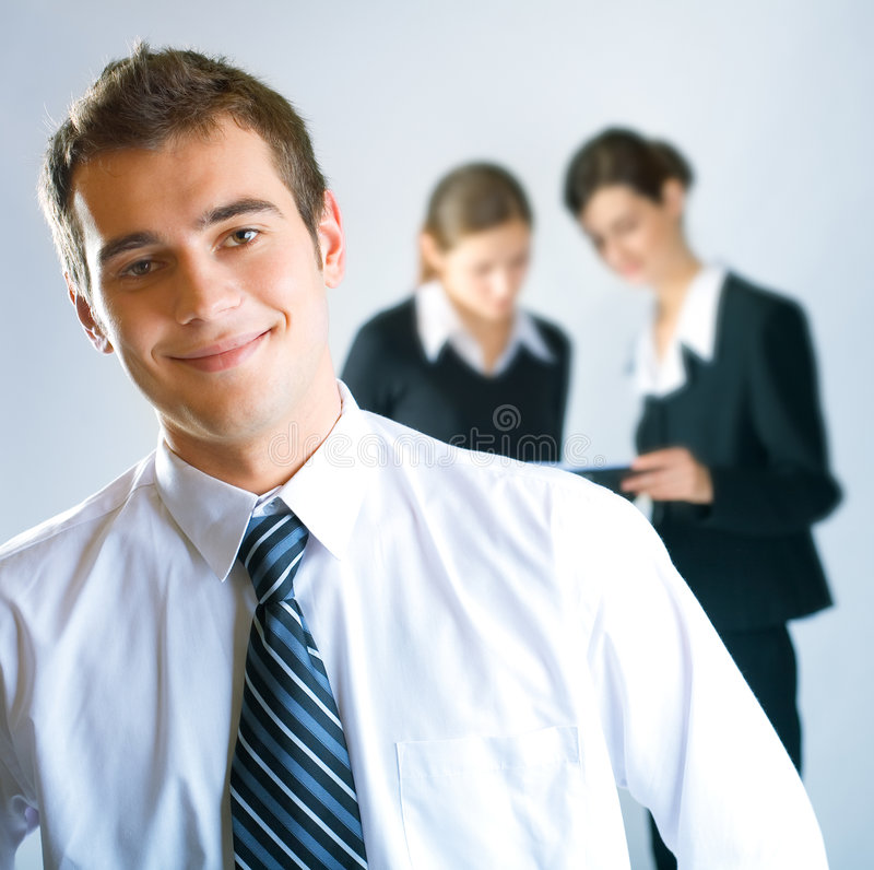 Three businesspeople. Three young successful businesspeople working at office stock images