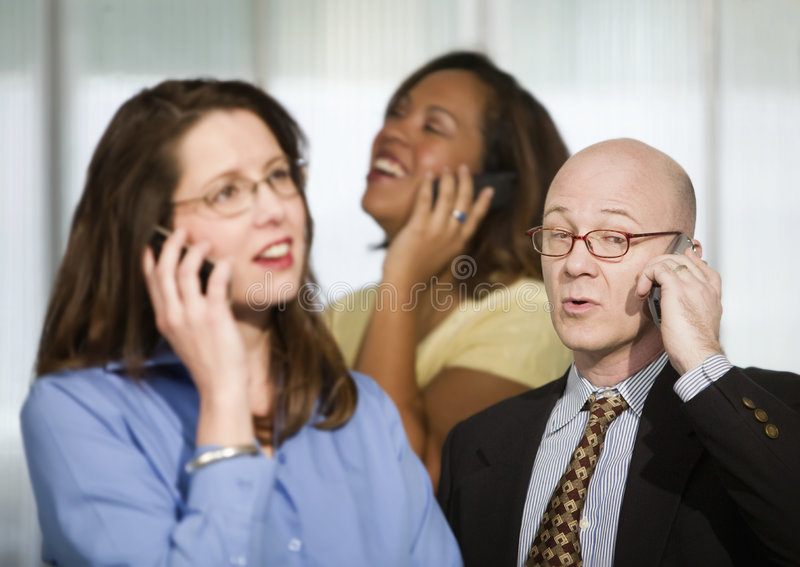 Three Businesspeople on Cell Phones stock photography