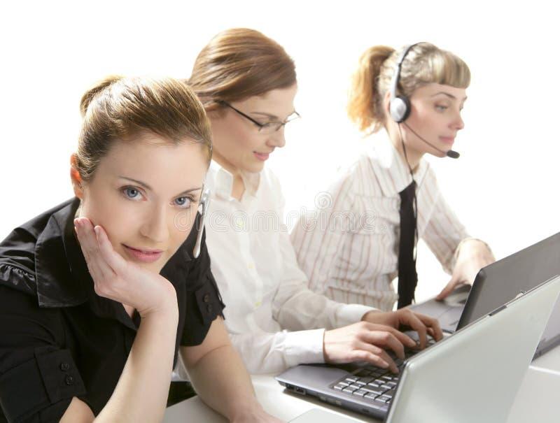 Three businesswoman helpdesk isolated on white