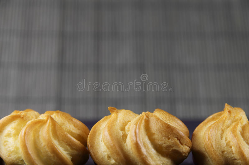 Three cakes on a bamboo background. Three stock images
