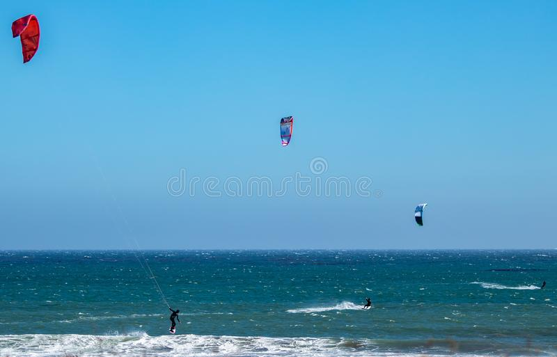 Three California wind surfers inline catching waves royalty free stock image