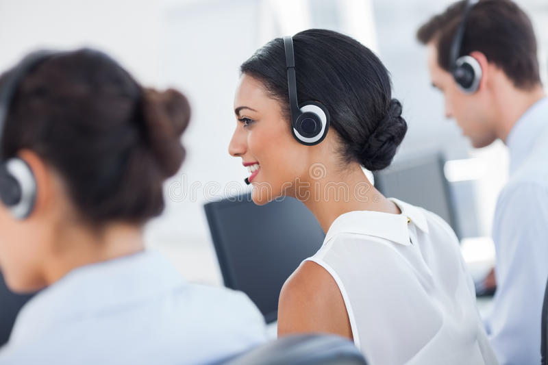 Three call centre employees working. In line royalty free stock photos