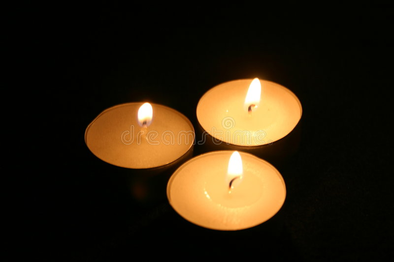 Three Candles in the Dark royalty free stock photo
