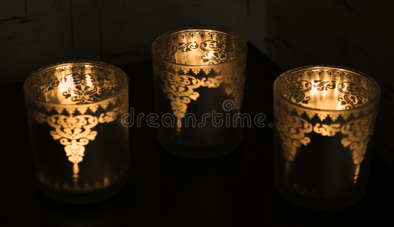 Three candles in a glass royalty free stock photos