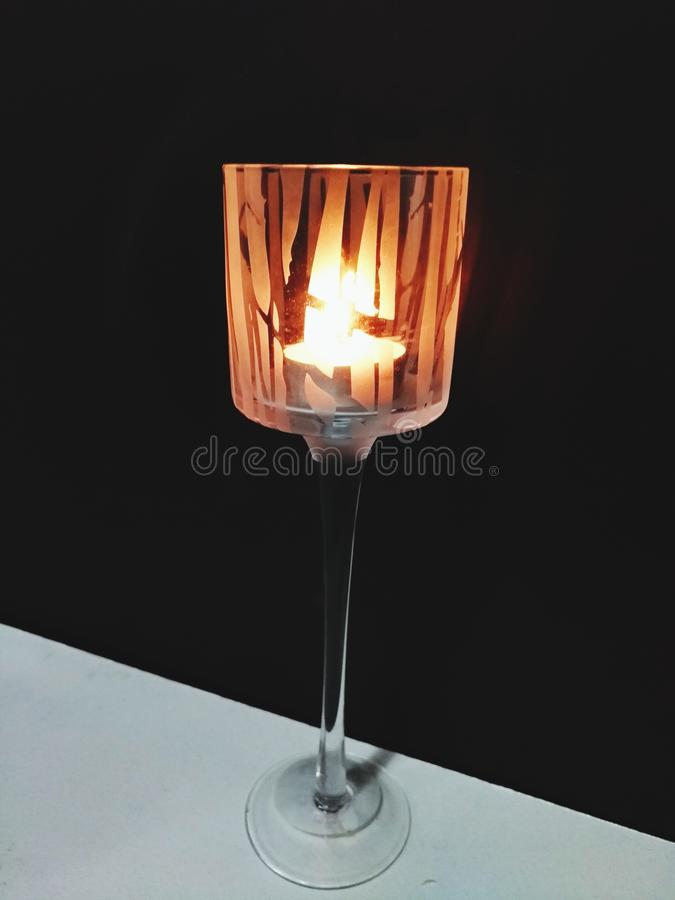 Three Candles in a row lighted up in a dark night of your room stock images