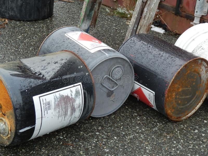 Toxic waste. Three cans of toxic waste sitting on the pavement royalty free stock photography