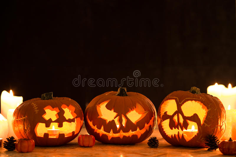 Three carved halloween pumpkin lanterns. Picture of three carved halloween pumpkin lanterns royalty free stock photography