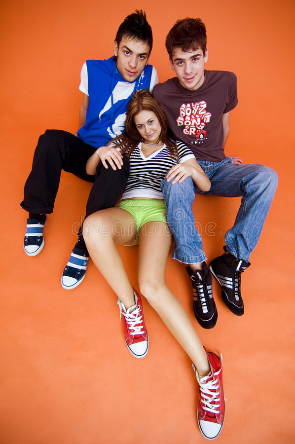 Download Three Casual Teens stock image. Image of looking, orange - 1958877