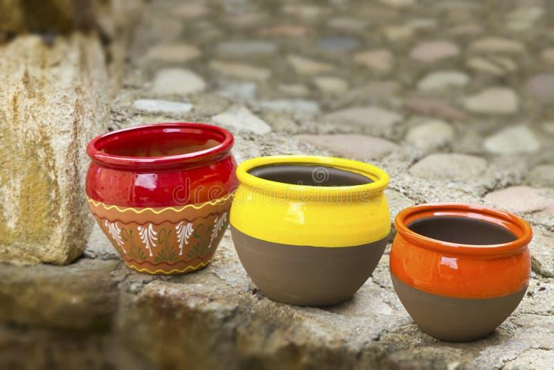 Three ceramic pots royalty free stock photo