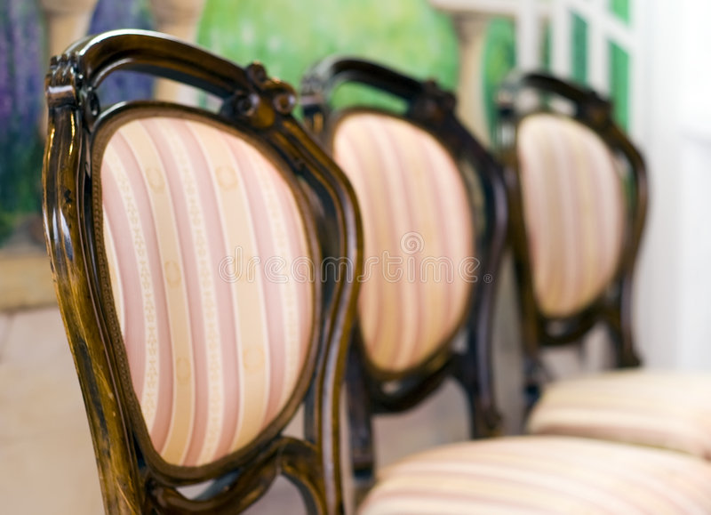 Three chairs. Three classic chairs in a row, focus on the first one royalty free stock image
