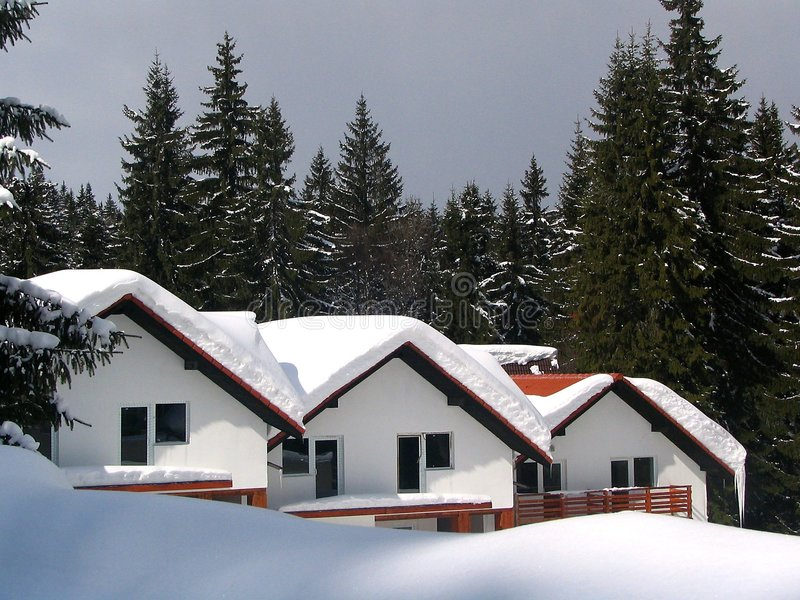 Three chalets - little noise. Three chalets in the winter covered with snow royalty free stock image